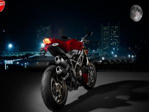 Ducati motorbike in front of the moon