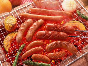 Sausages and vegetables on the grill