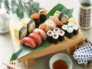 Small wooden table with Japanese food