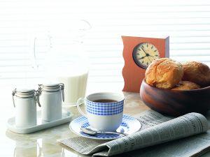 Breakfast with newspaper