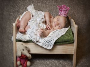 Baby sleeping in her little bed
