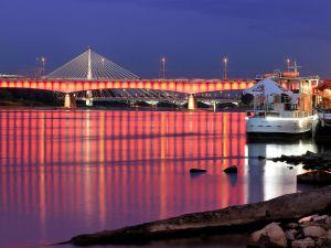 Bridge with lights over water
