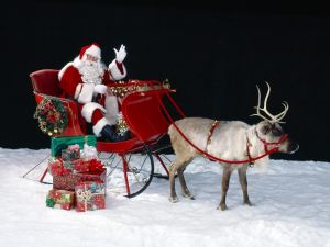 Santa Claus next to Christmas gifts