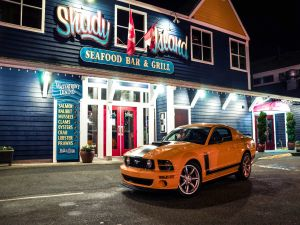 Ford Mustang, in the door of a seafood bar