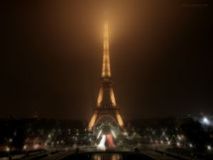 The night is full of light around the Eiffel Tower