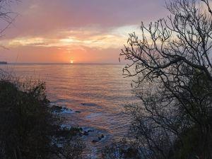 The sun sinking into the sea