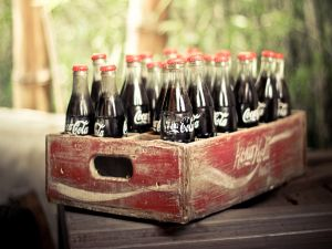 Bottles of Coca-Cola in an old wooden box
