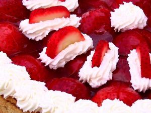 Strawberries with cream on a cake