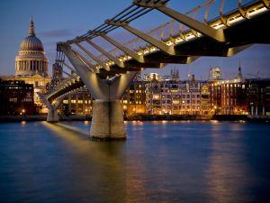 Illuminated Millennium Bridge over the River Thames
