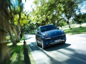 Porsche Cayenne, in motion on a road