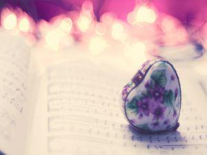 Little heart shaped box over a sheet music