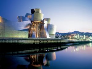Guggenheim Museum Bilbao, illuminated at dusk