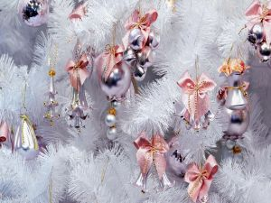 Pink ornaments on a white tree