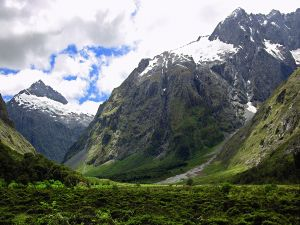 Green mountains with snow on top