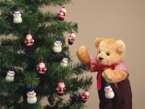 Teddy front of a Christmas tree