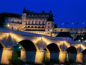 Château d'Amboise, and bridge illuminated over the Loire river