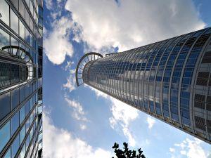 Looking at the sky between large buildings