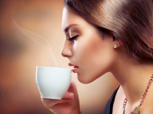 Drinking a steaming cup of coffee
