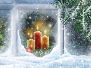 Candles and Christmas decorations in the window