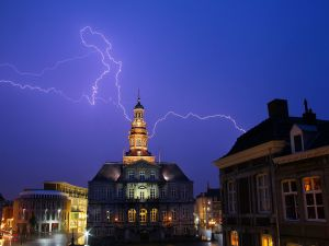 Lightning over town hall of Maastricht