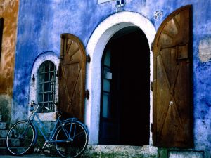 Blue bicycle on the house door