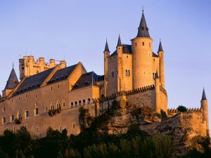 The sun illuminates the Alcazar of Segovia