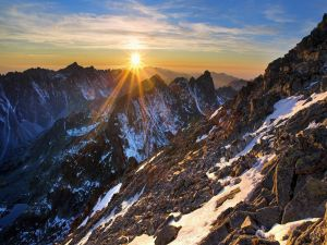 The sun rises in the mountains
