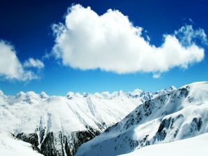 Snowy mountains and clouds in the sky