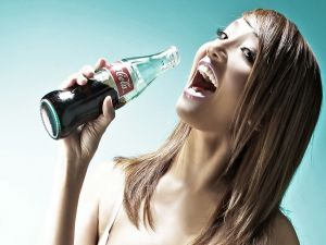 Girl drinking Coca-Cola