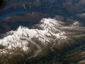 Flying over a snowy mountains