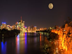 The full moon in the sky of a city