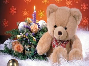 A teddy bear and a Christmas center