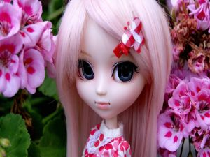 Doll with long and pink hair