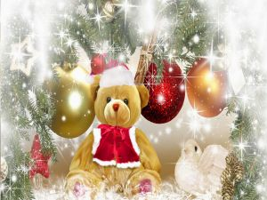 Teddy dress of Santa Claus and next to Christmas tree