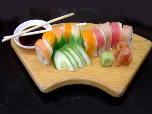 Wooden board with sushi