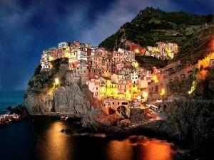 Houses lit on the coast