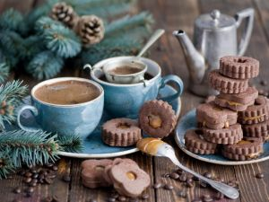 Chocolate cookies with caramel and coffee cups
