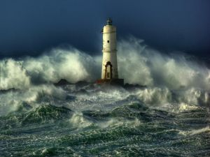 Lone lighthouse among the waves surging