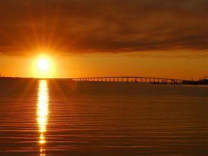 The sun rises and illuminates the water