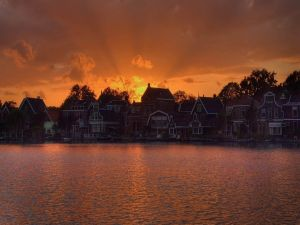 Houses on the lake at sunset