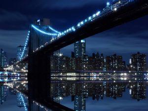 Skyscrapers and bridge lit