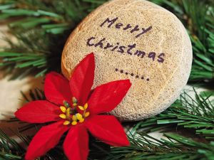 "Message ""Merry Christmas"" on a stone"