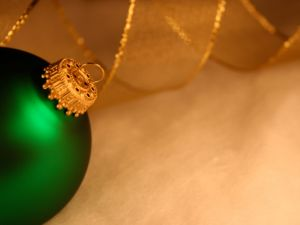 Green ball with golden cord
