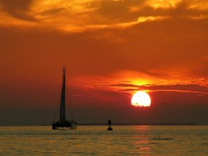 Catamaran on the water at sunset
