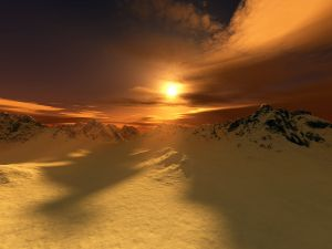 Snowy mountains and the sun at sunset