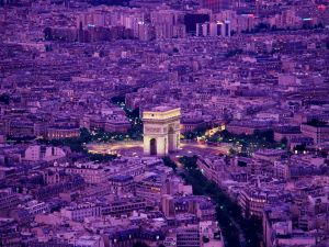 View of Paris and the Arc de Triomphe at dusk