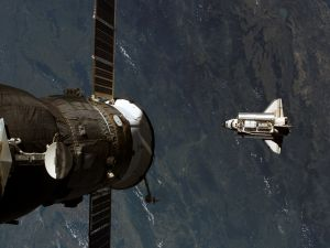 Satellite and Space Shuttle in orbit