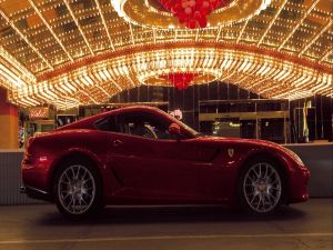 Red colored Ferrari under the lights
