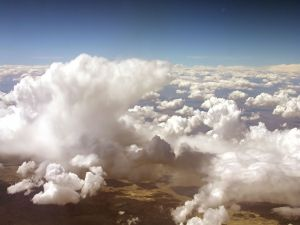 View of the land from above the clouds
