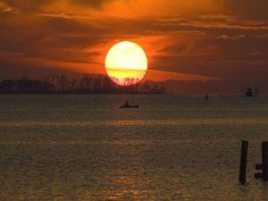 A large sun at sunset